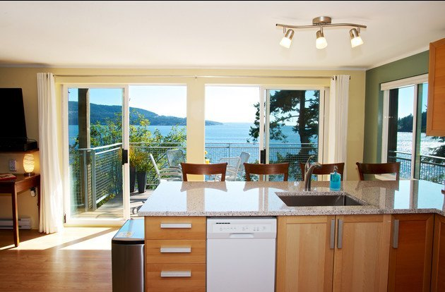 Waterfront views from the Newly renovated kitchen with granite counters & dishwasher