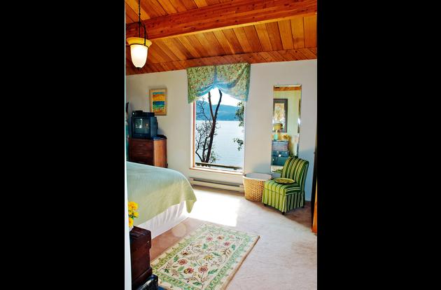 Hideaway seaside bedroom with plush queen bed and a view