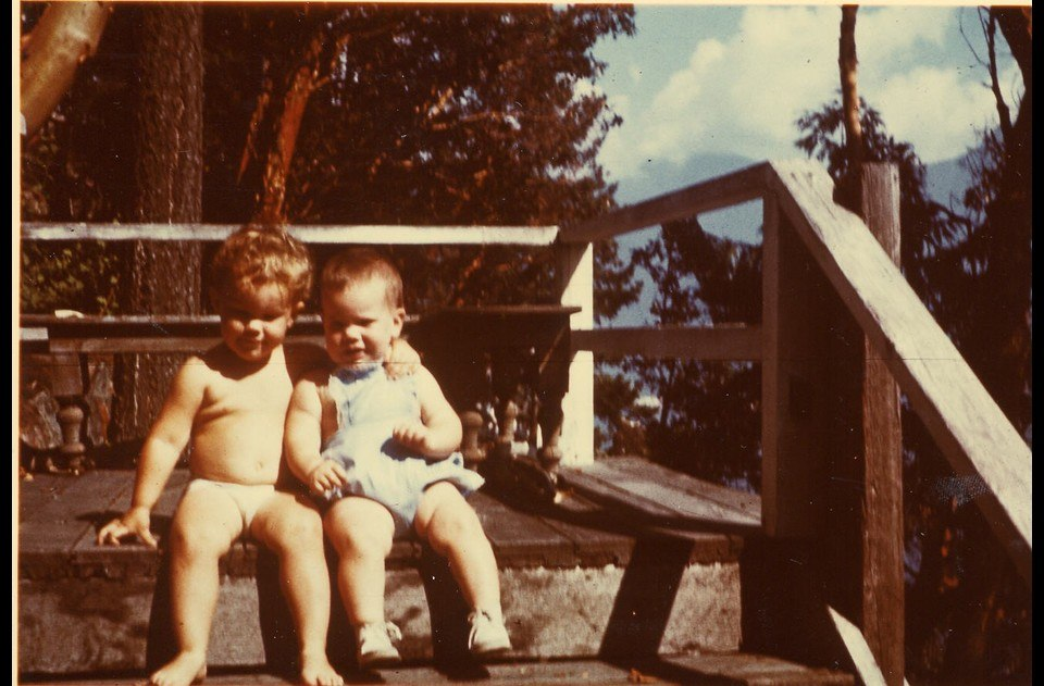 Mike & Jan sitting on the original cabin steps  1955